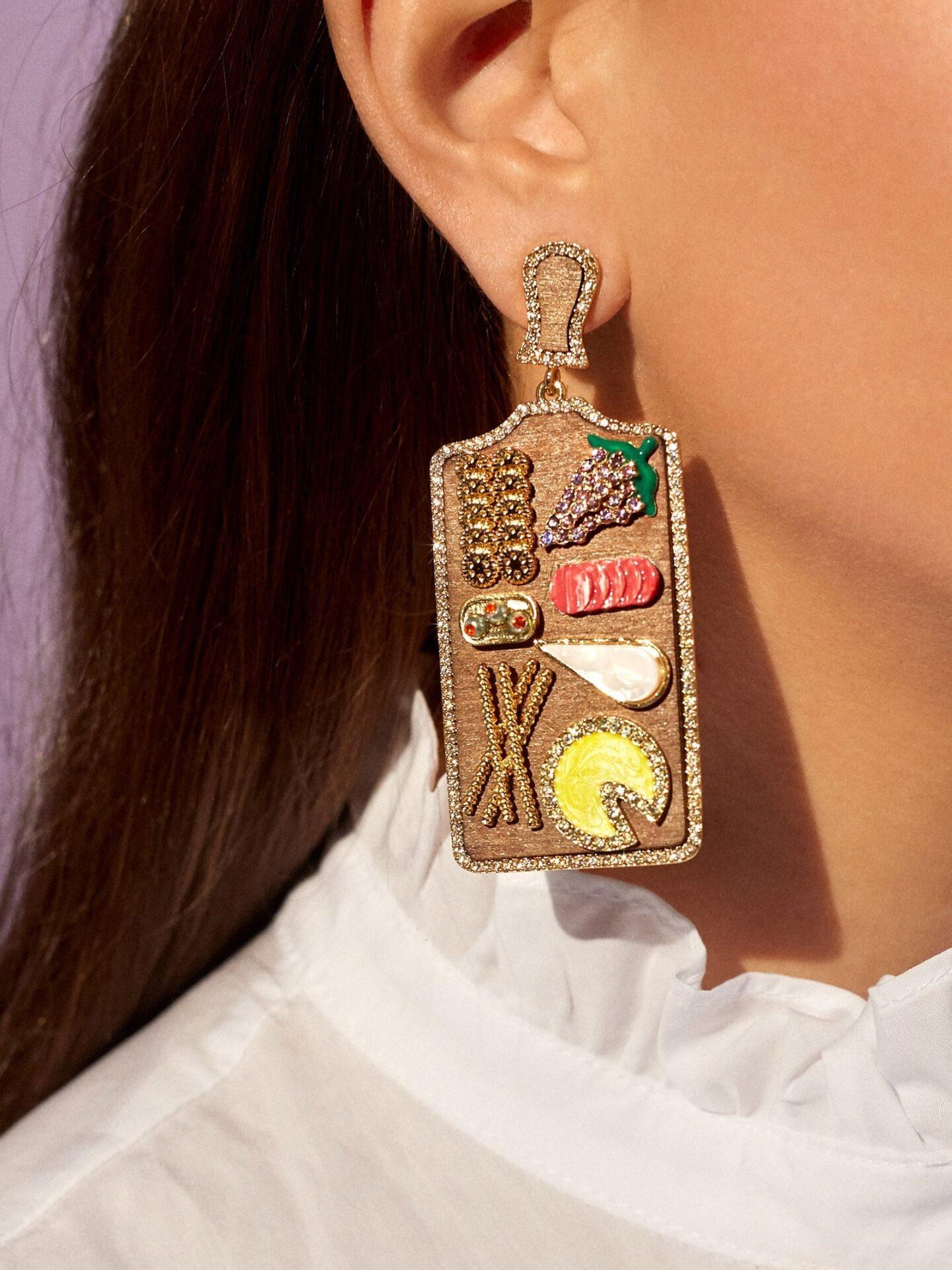 woman wearing food themed earrings