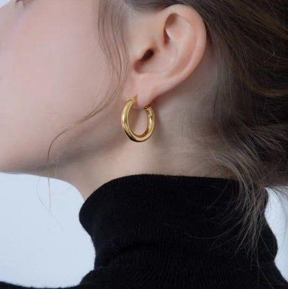 side photo of a woman wearing hoop earrings for Zoom Ready Jewelry